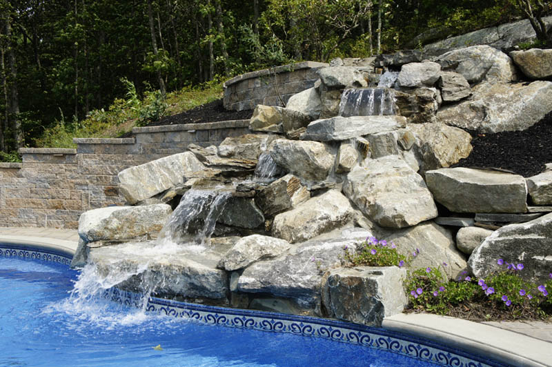 Large boulder waterfall cascading into pool
